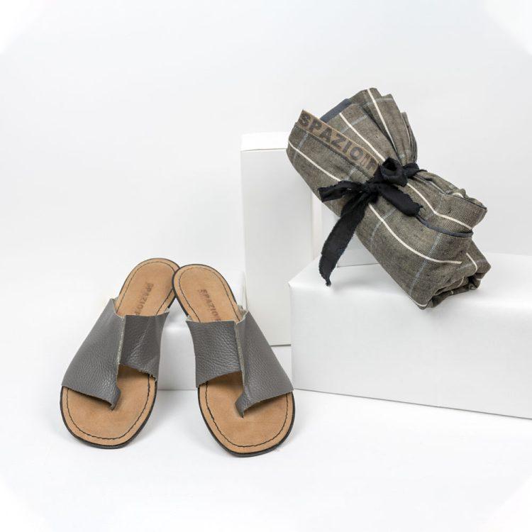 Gray thong sandal + beach towel
